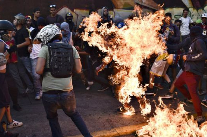 Afro-Venezuelan Orlando Figuera torched alive by opposition supporters